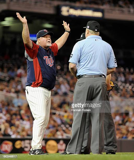 Ron Gardenhire of the Minnesota Twins speaks with umpires Dale Scott and Bill Miller during the fourth inning of the game against the Oakland...