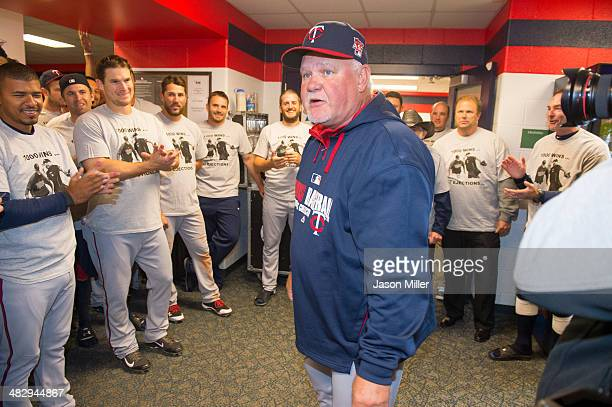 Ron Gardenhire of the Minnesota Twins talks with his players in the visitors dugout at Progressive Field after the Twins defeated the Cleveland...