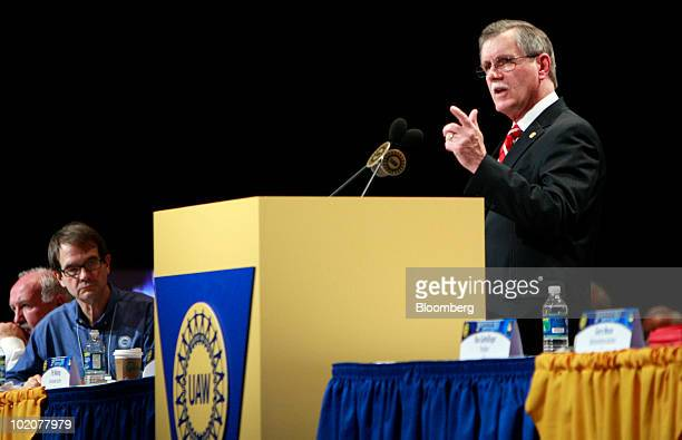 Ron Gettelfinger outgoing president of the United Auto Workers speaks at the UAW's constitutional convention as Bob King the incoming UAW president...