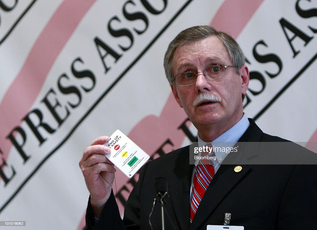 Ron Gettelfinger, president of the United Auto Workers, holds a 'Stand Up For Safety' card as he speaks to the Automotive Press Association in Detroit, Michigan, U.S., on Thursday, May 27, 2010. Gettelfinger, who helped secure U.S. bailouts for General Motors Co. and Chrysler Group LLC, said the union's membership has leveled off and will begin growing again. Photographer: Jeff Kowalsky/Bloomberg via Getty Images