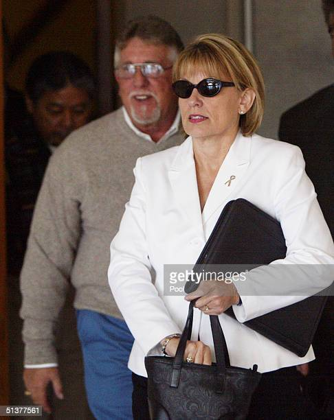 Ron Grantski and Sharon Rocha stepfather and mother of murder victim Laci Peterson leaves the San Mateo County Courthouse for a lunch break in the...