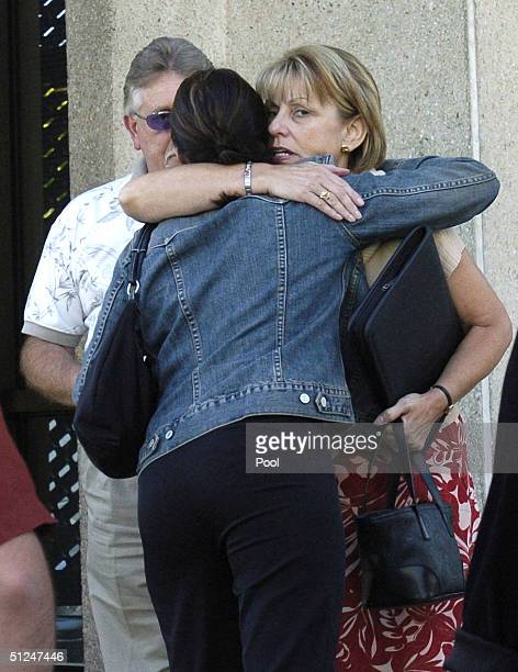 Ron Grantski watches as Amy Rocha Laci Peterson's sister and Sharon Rocha Laci Peterson's mother embrace after the trial hearing at San Mateo County...