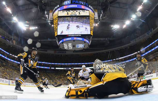 Ron Hainsey and Brian Dumoulin of the Pittsburgh Penguins watches as goaltender Matt Murray makes a save during the second period of Game Two of the...