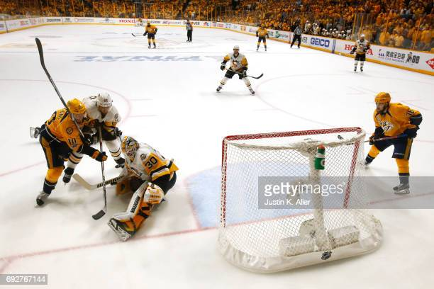 Ron Hainsey and Matt Murray of the Pittsburgh Penguins defend the net against Colton Sissons of the Nashville Predators in Game Four of the 2017 NHL...