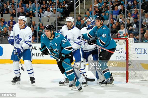 Ron Hainsey Nazem Kadri and Frederik Andersen of the Toronto Maple Leafs defend Logan Couture and Tomas Hertl of the San Jose Sharks at SAP Center on...
