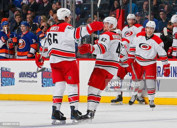 Ron Hainsey of the Carolina Hurricanes is congratulated by his teammate Joakim Nordstrom after scoring the game winning goal in overtime against the...
