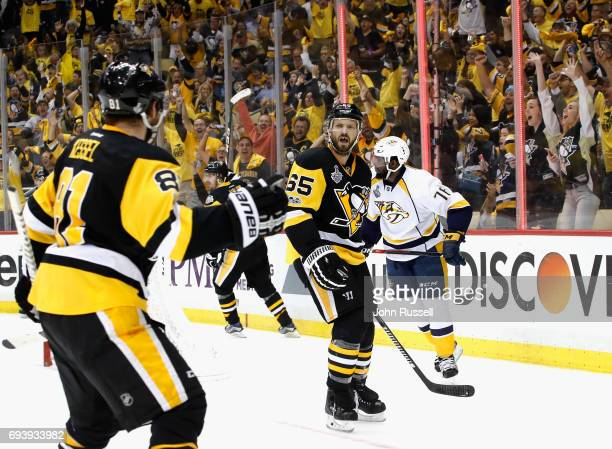 Ron Hainsey of the Pittsburgh Penguins reacts to teammate Phil Kessel after scoring a goal on goaltender Juuse Saros of the Nashville Predators...