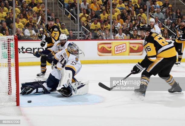Ron Hainsey of the Pittsburgh Penguins scores a goal on goaltender Juuse Saros of the Nashville Predators during the second period of Game Five of...