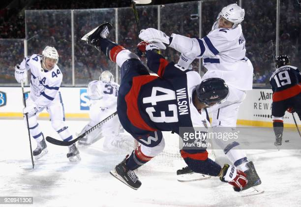 Ron Hainsey of the Toronto Maple Leafs collides with Tom Wilson of the Washington Capitals during the second period of the 2018 Coors Light NHL...