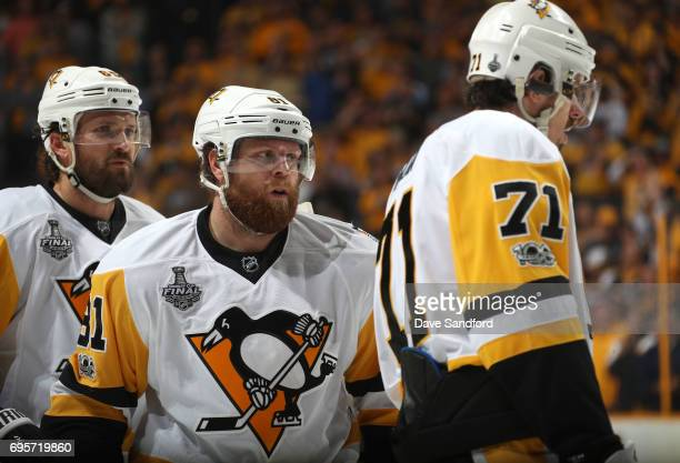 Ron Hainsey Phil Kessel and Evgeni Malkin of the Pittsburgh Penguins look on during a break in play in the second period of Game Six of the 2017 NHL...
