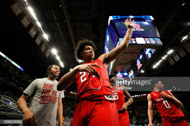 Ron Harper Jr. #24 of the Rutgers Scarlet Knights celebrates with teammates after defeating the Clemson Tigers in the first round game of the 2021...