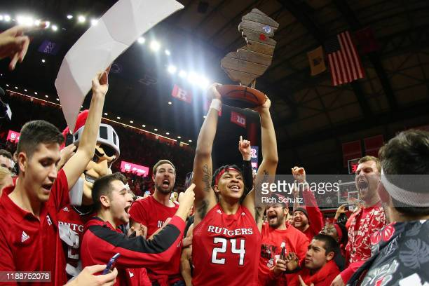 Ron Harper Jr. #24 of the Rutgers Scarlet Knights celebrates with the Garden State Hardwood Classic Trophy after defeating cross state rivals Seton...