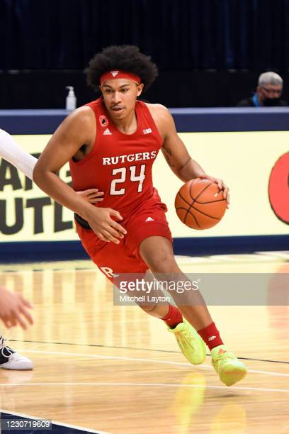 Ron Harper Jr. #24 of the Rutgers Scarlet Knights dribbles the ball in the second half during a college basketball game against the Penn State...
