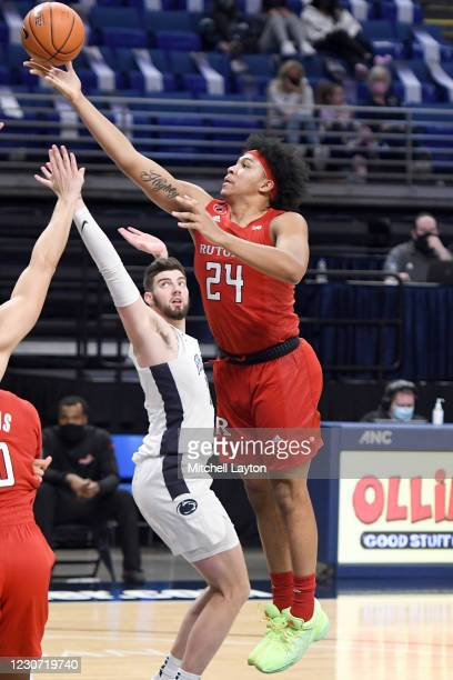 Ron Harper Jr. #24 of the Rutgers Scarlet Knights drives to the basket in the second half during a college basketball game against the Penn State...