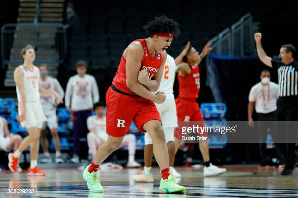 Ron Harper Jr. #24 of the Rutgers Scarlet Knights reacts after defeating the Clemson Tigers in the first round game of the 2021 NCAA Men's Basketball...
