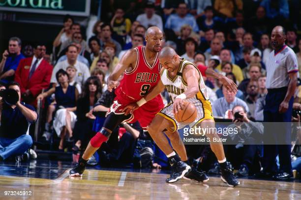 Ron Harper of the Chicago Bulls defends Mark Jackson of the Indiana Pacers during a game played on May 25 1998 at the Market Square Arena in...