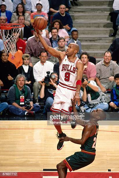 Ron Harper of the Chicago Bulls goes for a layup past Gary Payton of the Seattle SuperSonics during Game One of the NBA Finals at the United Center...