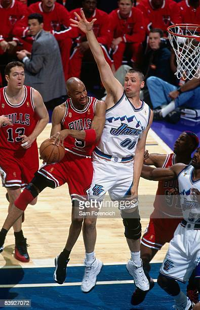 Ron Harper of the Chicago Bulls goes up for a shot againt Greg Ostertag of the Utah Jazz in Game Four of the 1997 NBA Finals at the Delta Center on...