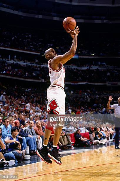 Ron Harper of the Chicago Bulls shoots a jump shot in Game Six of the 1996 NBA Finals against the Seattle SuperSonics at the United Center on June 16...