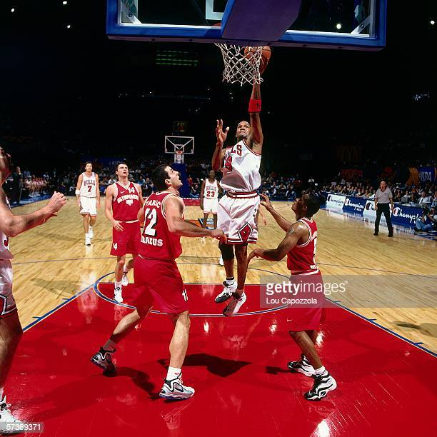 Ron Harper of the Chicago Bulls shoots a layup against Olympiakos during the 1997 McDonalds Championships played at the Palais Omnisports de...