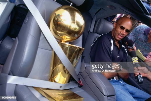 Ron Harper of the Chicago Bulls with the Larry O'Brien NBA Championship Trophy during the 1998 Chicago Bulls Celebration Rally on June 16 1998 at...