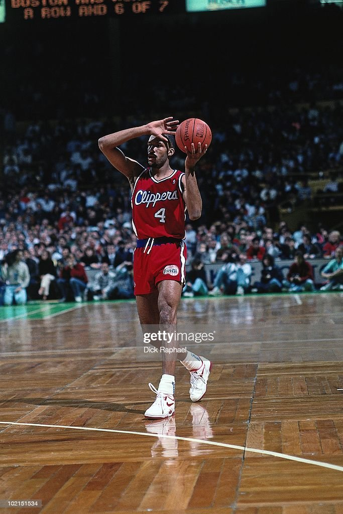 Ron Harper #4 of the Los Angeles Clippers passes against the Boston Celtics during a game played in 1990 at the Boston Garden in Boston, Massachusetts.