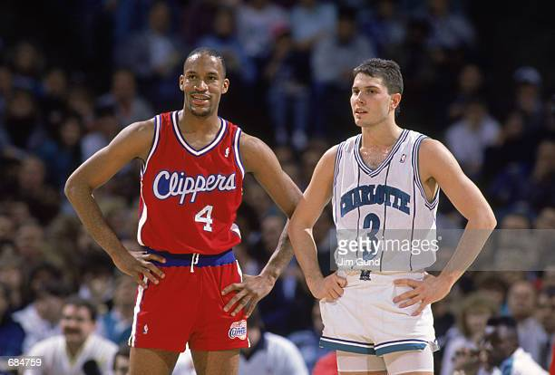Ron Harper of the Los Angeles Clippers stands next to Rex Chapman of the Charlotte Hornets during the NBA game NOTE TO USER User expressly...