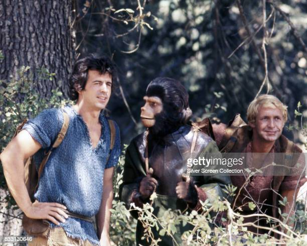 Ron Harper Roddy McDowall and James Naughton on the set of the US television series 'Planet of the Apes' USA circa 1974 The science fiction series...