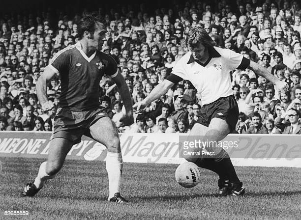 Ron Harris of Chelsea moves in to tackle Leighton James of Derby County during a first Division match at Stamford Bridge London 10th September 1977...