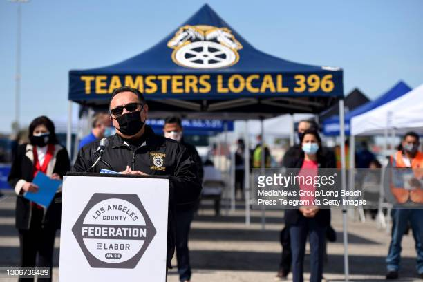 Ron Herrera, Director of the International Brotherhood of Teamsters Ports Division speaks during a press conference at an outdoor vaccine clinic...
