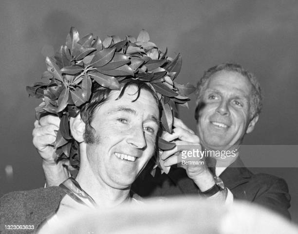 Ron Hill of Cheshire, England, flashes a big smile as he receives the traditional laurel wreath from Mayor Kevin White after he won the 75th Annual...