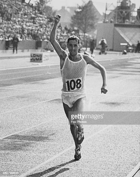 Ron Hill of England crosses the line to win the Marathon at Meadowbank Stadium during the British Commonwealth Games in Edinburgh Scotland 23rd July...
