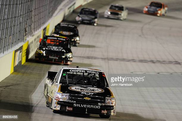 Ron Hornaday Jr driver of the Georgia Boot Chevrolet leads a pack of trucks into turn 1 during the NASCAR Camping World Truck Series O'Reilly 200 at...
