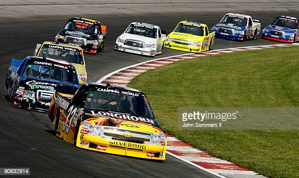 Ron Hornaday Jr driver of the Longhorn Chevrolet leads the field during the Camping World truck race Copart 200 at the Gateway International Raceway...