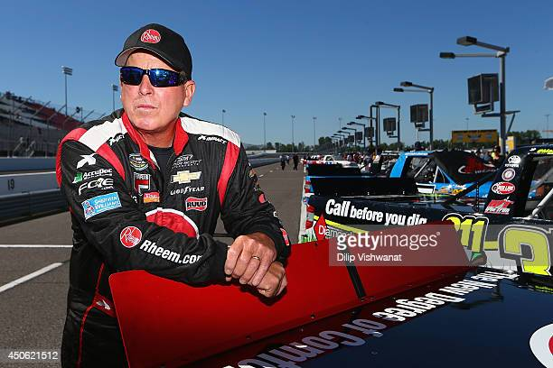 Ron Hornaday Jr driver of the Rheem Chevrolet waits during qualifying for the NASCAR Camping World Truck Series Drivin' for Linemen 200 at Gateway...