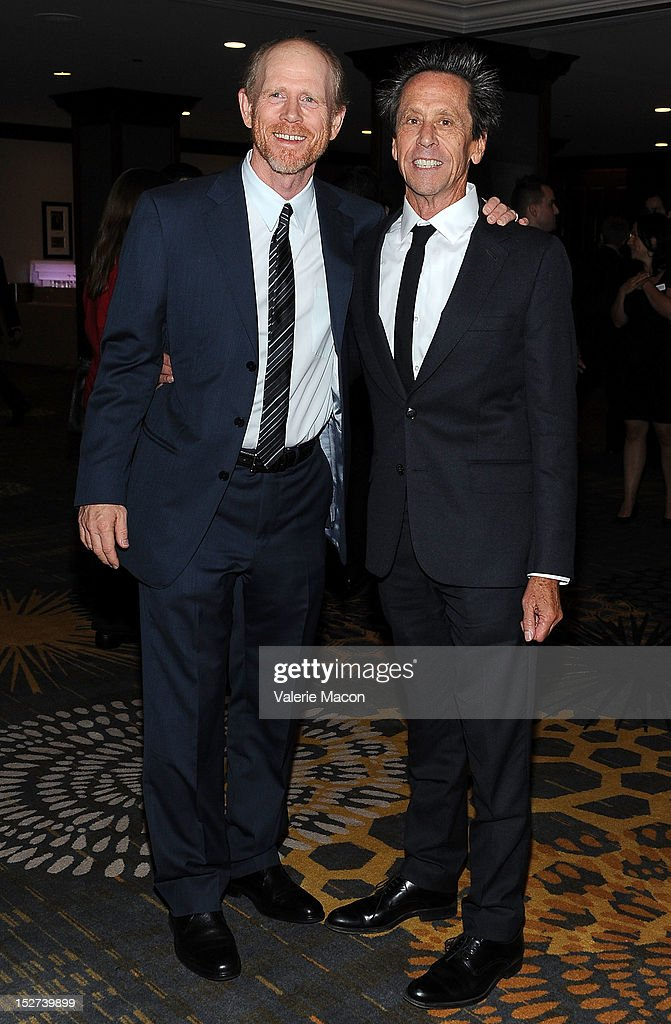 Ron Howard (L) and Brian Grazer arrive at The National Multiple Sclerosis Society's 38th Annual Dinner Of Champions at the Hyatt Regency Century Plaza on September 24, 2012 in Los Angeles, California.