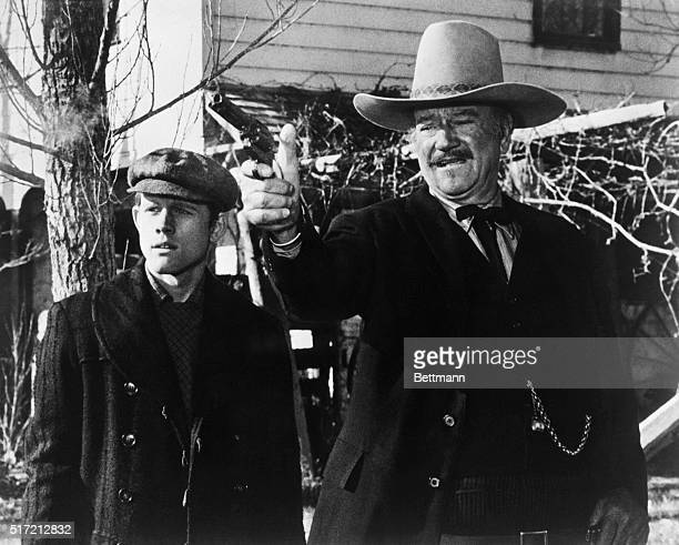 Ron Howard and John Wayne in a scene from the 1976 movie The Shootist