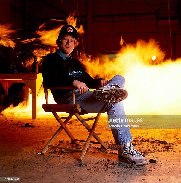 Ron Howard in director's chair with fire behind him June 6 1990 Shot for Newsweek story