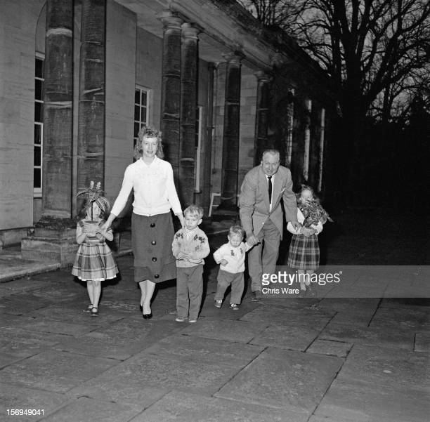 L Ron Hubbard writer of science fiction and founder of the Church of Scientology outside his Sussex mansion Saint Hill Manor with his family December...