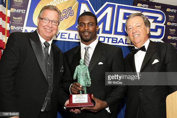 Ron Jaworski, Michael Vick, Philadelphia Eagles QB and winner of the 52nd Annual Bert Bell Award for the Professional Player of the Year along with...