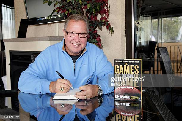 """Ron Jaworski signs copies of his book """"The Games That Changed the Game"""" during his Jaws Youth Fund Fall Golf Classic at Valleybrook Country Club..."""