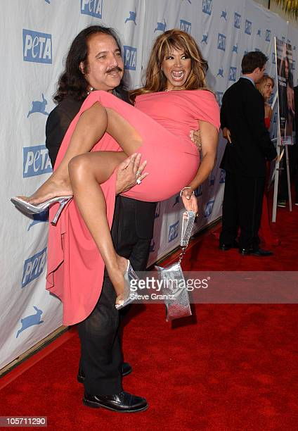 Ron Jeremy and Traci Bingham during PETA's 25th Anniversary Gala and Humanitarian Awards Show Red Carpet at Paramount Pictures in Hollywood...