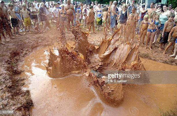 Ron Johnson demonstrates his first place form in the Mudpit Belly Flop competition during the Seventh Annual Summer Redneck Games on July 5, 2002 in...