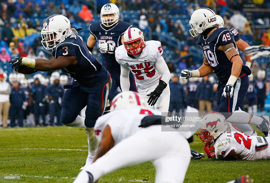 Ron Johnson #3 of the Connecticut Huskies reaches out for the touchdown in the second half against the SMU Mustangs during the game at Rentschler Field on December 6, 2014 in East Hartford, Connecticut.