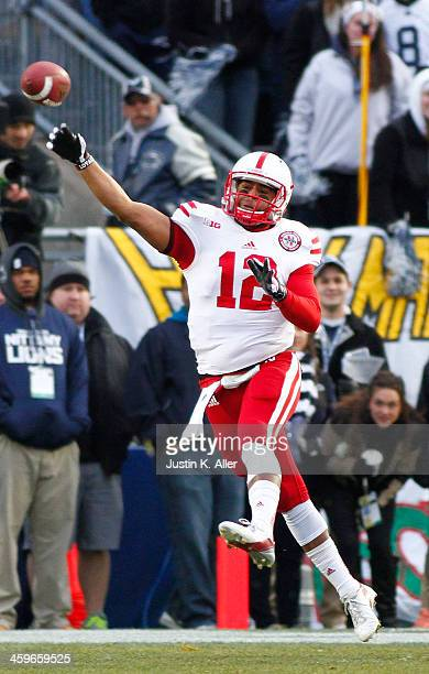 Ron Kellogg III of the Nebraska Cornhuskers drops back to pass against the Penn State Nittany Lions during the game on November 23 2013 at Beaver...