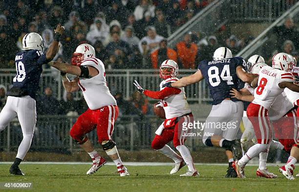 Ron Kellogg III of the Nebraska Cornhuskers is pressured by the Penn State Nittany Lions during the game on November 23 2013 at Beaver Stadium in...