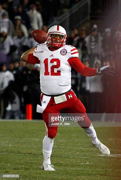 Ron Kellogg III of the Nebraska Cornhuskers rolls out to pass against the Penn State Nittany Lions during the game on November 23 2013 at Beaver...