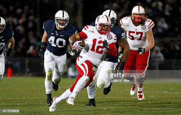 Ron Kellogg III of the Nebraska Cornhuskers rushes against the Penn State Nittany Lions during the game on November 23 2013 at Beaver Stadium in...