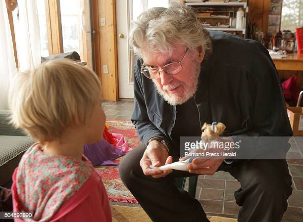 Ron King talks with Mae Schultz about a doll she got for Christmas while King was visiting with Schultz's family at King Hill Farm in Penobscot on...