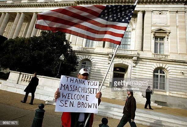 Ron Kirby of Alexandria, Virginia, stands in front of the Russell Senate Office Building on Capitol Hill to show his support for Massachusetts U.S....